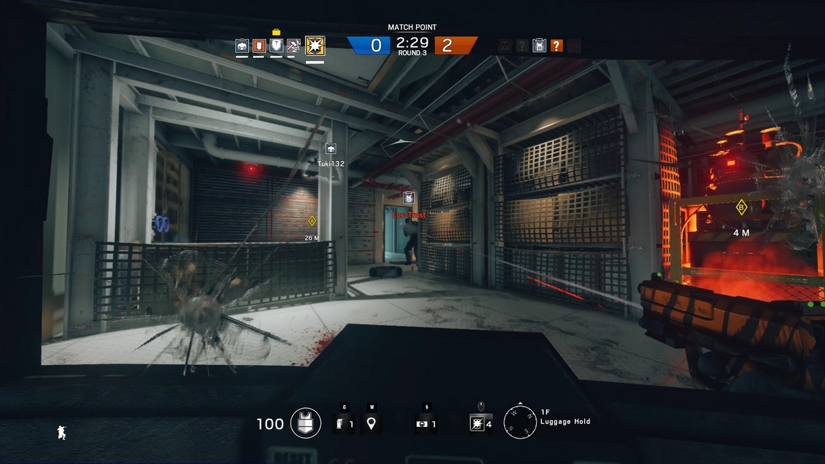 Certain operators in Rainbow Six Siege can use shields, which makes for fun engagements. In this screenshot, I was invading a particular room with some support coming from the left flank. But because I was facing the enemy directly, I would be hard to take out. (Unless they use grenades or explosives, which counter shields.) Teamwork and communication with teammates is key here.